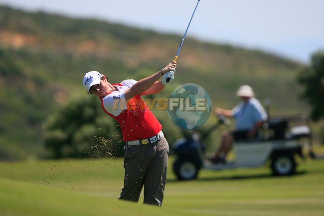 Rory McIlroy (N.IRL) plays his 2nd shot on the 16th hole during the morning session on Day 3 of the Volvo World Match Play Championship in Finca Cortesin, Casares, Spain, 21st May 2011. (Photo Eoin Clarke/Golffile 2011)