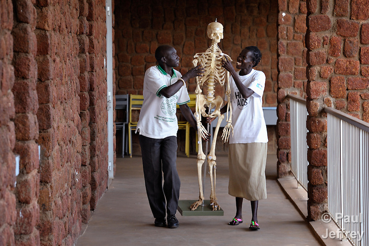Students at the Catholic Health Training Institute in Wau, South Sudan, carry a skeleton between classrooms. CHTI trains nurses and midwives in the newly independent country, and is coordinated by Solidarity with South Sudan, an international consortium of more than 200 religious congregations that trains teachers, health workers and pastoral personnel in several locations throughout South Sudan.