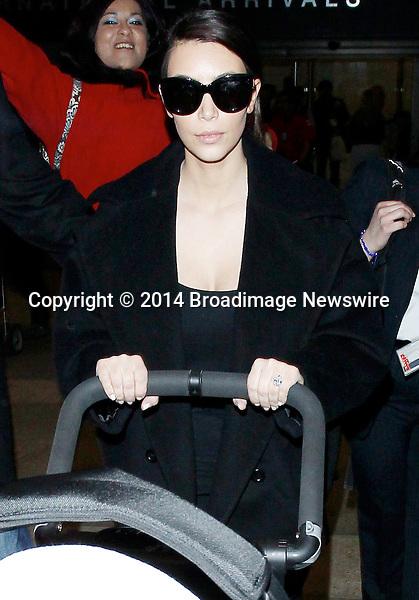 Pictured: Kim Kardashian<br /> Mandatory Credit &copy; CALA/Broadimage<br /> Kim Kardashian arriving at the Los Angeles International Airport<br /> <br /> 2/28/14, Los Angeles, California, United States of America<br /> <br /> Broadimage Newswire<br /> Los Angeles 1+  (310) 301-1027<br /> New York      1+  (646) 827-9134<br /> sales@broadimage.com<br /> http://www.broadimage.com