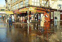 Water flows freely after a watermain break at Delancey and Allen Streets in the Lower East Side neighborhood of New York in the winter of 1987. (© Frances M. Roberts)