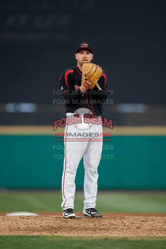 Rochester Red Wings relief pitcher Dietrich Enns (20) looks in for the sign during a game against the Lehigh Valley IronPigs on September 1, 2018 at Frontier Field in Rochester, New York.  Lehigh Valley defeated Rochester 2-1.  (Mike Janes/Four Seam Images)