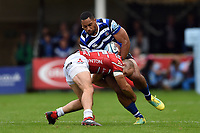 Joe Cokanasiga of Bath Rugby is tackled by Charlie Sharples of Gloucester Rugby. Gallagher Premiership match, between Bath Rugby and Gloucester Rugby on September 8, 2018 at the Recreation Ground in Bath, England. Photo by: Patrick Khachfe / Onside Images