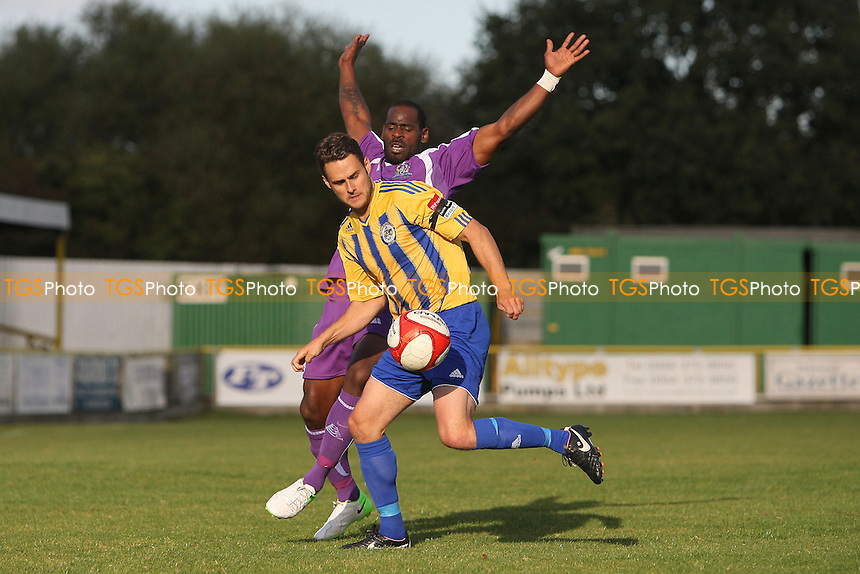 Paul Clayton of Romford tussles with Leroy Griffiths of Thurrock - Romford vs Thurrock - FA Challenge Trophy 1st Round Football at Ship Lane, Thurrock FC - 29/09/12 - MANDATORY CREDIT: Gavin Ellis/TGSPHOTO - Self billing applies where appropriate - 0845 094 6026 - contact@tgsphoto.co.uk - NO UNPAID USE.
