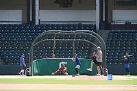 John Parke of the Chicago White Sox pitches to Chase Barbary of the Los Angeles Dodgers as Tomas Frick from J.L. Mann High catches at a workout during the coronavirus shutdown with local Major League and Minor League players from around the Upstate on Tuesday, June 2, 2020, at Fluor Field at the West End in Greenville, South Carolina. (Tom Priddy/Four Seam Images)
