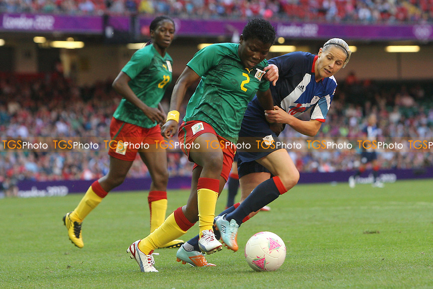 Kelly SMITH of Great Britain tangles with Christine MANIE of Cameroon - Great Britain Women vs Cameroon Women - Womens Olympic Football Tournament London 2012 Group E at the Millenium Stadium, Cardiff, Wales - 28/07/12 - MANDATORY CREDIT: Gavin Ellis/SHEKICKS/TGSPHOTO - Self billing applies where appropriate - 0845 094 6026 - contact@tgsphoto.co.uk - NO UNPAID USE.