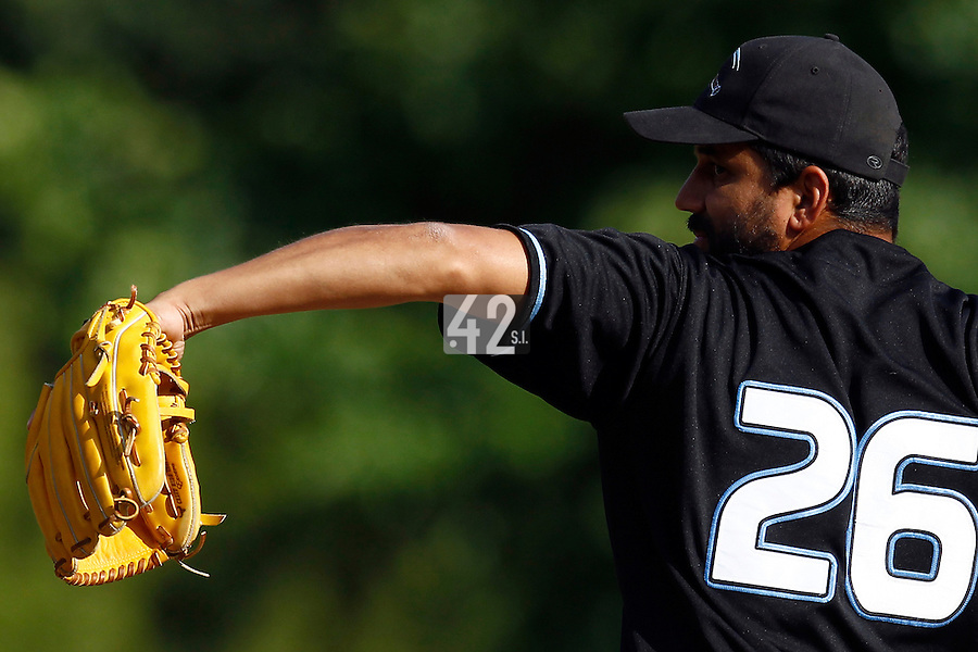 15 July 2011: Starting pitcher Jamel Boutagra of the Senart Templiers pitches against the Rouen Huskies  during the 2011 Challenge de France match won 6-5 by the Rouen Huskies over the Senart Templiers at Stade Pierre Rolland, in Rouen, France.