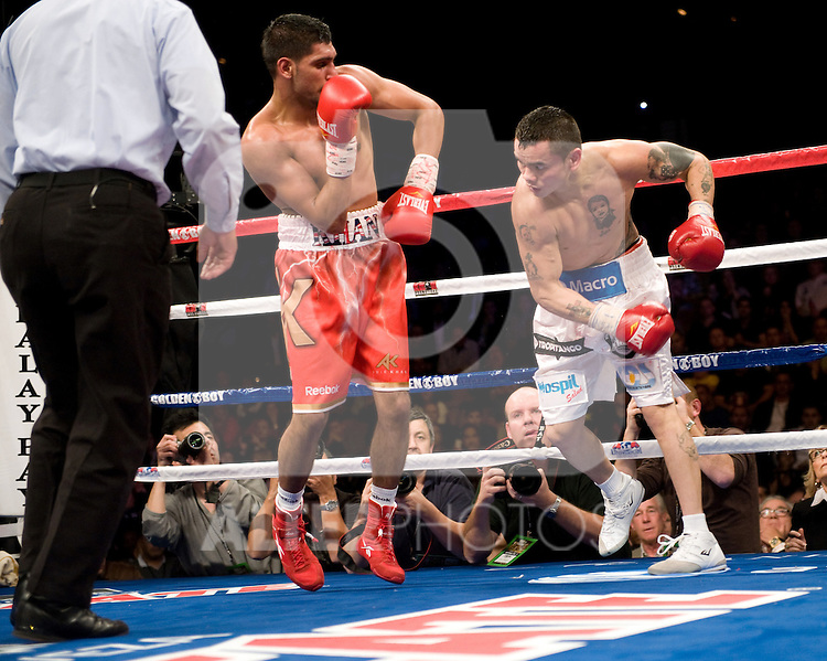 Dec. 11, 2010: WBA super lightweight champion Amir Khan (24-1, 17 KOs) won a twelve round firefight against WBA interim super lightweight titleholder Marcos Maidana (29-2, 27 KOs) . Scores were 114-111, 114-111, and 113-112.