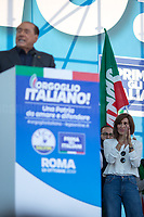 """(From L to R) Silvio Berlusconi MEP (Media tycoon, four times Prime Minister of Italy, leader of Forza Italia party) & Anna Maria Bernini MP (Member of Parliament for Forza Italia).<br /> <br /> Rome, 19/10/2019. Today, tens thousands of people (200,000 for the organisers, 50,000 for the police) gathered in Piazza San Giovanni to attend the national demonstration """"Orgoglio Italiano"""" (Italian Pride) of the far-right party Lega (League) of Matteo Salvini. The demonstration was supported by Silvio Berlusconi's party Forza Italia and Giorgia Meloni's party Fratelli d'Italia (Brothers of Italy, right-wing).  <br /> The aim of the rally was to protest against the Italian coalition Government (AKA Governo Conte II, Conte's Second Government, Governo Giallo-Rosso, 1.) lead by Professor Giuseppe Conte. The 66th Government of Italy is a coalition between Five Star Movement (M5S, 2.), Democratic Party (PD – Center Left, 3.), and Liberi e Uguali (LeU – Left, 4.), these last two parties replaced Lega / League as new members of a coalition based on Parliamentarian majority as stated in the Italian Constitution. The Governo Conte I (Conte's First Government, 5.) was 14-month-old when, between 8 and 9 of August 2019, collapsed after the Interior Minister Matteo Salvini withdrew his euroskeptic, anti-migrant, right-wing Lega / League (6.) from the populist coalition in a pindaric attempt (miserably failed) to trigger a snap election.<br /> <br /> Footnotes & Links:<br /> 1. http://bit.do/feK6N<br /> 2. http://bit.do/e7JLx<br /> 3. http://bit.do/e7JKy<br /> 4. http://bit.do/e7JMP<br /> 5. http://bit.do/e7JH7<br /> 6. http://bit.do/eE7Ey<br /> https://www.leganord.org<br /> http://bit.do/feK9X (Source, TheGuardian.com)<br /> Reportage: """"La Fabbrica Della Paura"""" (The Factory of Fear): http://bit.do/feLcy (Source Report, Rai.it - ITA)<br /> (Update) Reportage: """"La Fabbrica Social Della Paura"""" (The Social Network Factory of Fear): http://bit.do/fe8Pn (Source Report, Rai.it - ITA)"""