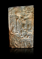 Pictures & images of the North Gate Hittite sculpture stele men hunting. 8th century BC.  Karatepe Aslantas Open-Air Museum (Karatepe-Aslantaş Açık Hava Müzesi), Osmaniye Province, Turkey. Against black background