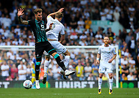 Leeds United's Patrick Bamford competes in the air with Swansea City's Joe Rodon<br /> <br /> Photographer Alex Dodd/CameraSport<br /> <br /> The EFL Sky Bet Championship - Leeds United v Swansea City - Saturday 31st August 2019 - Elland Road - Leeds<br /> <br /> World Copyright © 2019 CameraSport. All rights reserved. 43 Linden Ave. Countesthorpe. Leicester. England. LE8 5PG - Tel: +44 (0) 116 277 4147 - admin@camerasport.com - www.camerasport.com