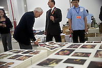 "Visiting dignitaries look at picture Bible pages printed in the Amity Printing Company's new printing facility in Nanjing, China....On May 18, 2008, the Amity Printing Company in Nanjing, Jiangsu Province, China, inaugurated its new printing facility in southern Nanjing.  The facility doubles the printing capacity of the company, now up to 12 million Bibles produced in a year, making Amity Printing Company the largest producer of Bibles in the world.  The company, in cooperation with the international organization the United Bible Societies, produces Bibles for both domestic Chinese use and international distribution.  The company's Bibles are printed in Chinese and many other languages.  Within China, the Bibles are distributed both to registered and unregistered Christians who worship in illegal ""house churches."""