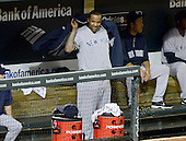 New York Yankees pitcher C.C. Sabathia (52) puts on his warm-up jacket in the dugout after being pulled from the game in the bottom of the seventh inning against the Baltimore Orioles at Oriole Park at Camden Yards in Baltimore, Maryland on Monday, May 20, 2013.  The Yankees won the game 6 - 4..Credit: Ron Sachs / CNP.(RESTRICTION: NO New York or New Jersey Newspapers or newspapers within a 75 mile radius of New York City)