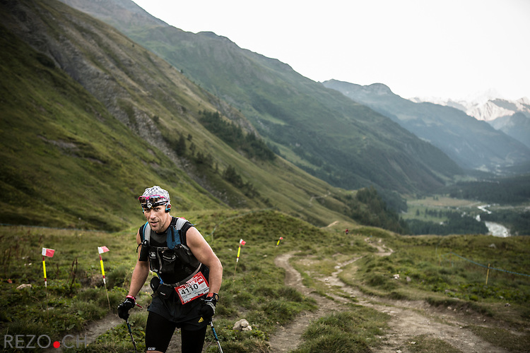 Pre' de Bar, Courmayeur, Italy - 08/31/2013: Czech runner Zbynek CYPRA. Early in the morning, runners continue their road toward Switzerland through Val Ferret. Credit: Niels Ackermann / Rezo.ch