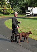 United States President Bill Clinton and his dog, Buddy, depart the White House in Washington, DC en route to the family vacation on Martha's Vineyard, Massachusetts on Thursday, August 19, 1999.  On Tuesday, August 17, 1999, the President testified before the Grand Jury on his involvement in the Monica Lewinsky scandal and subsequently made a nationally televised statement admitting he had an inappropriate relationship with Ms. Lewinsky<br /> Credit: Ron Sachs / CNP
