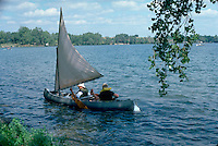 Friends age 15 in a canoe rigged for sailing.  Clitherall Minnesota USA