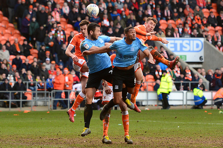 Ben Heneghan and Chris Long of Blackpool go up for a header<br /> <br /> Photographer Richard Martin-Roberts/CameraSport<br /> <br /> The EFL Sky Bet League One - Blackpool v Southend United - Saturday 9th March 2019 - Bloomfield Road - Blackpool<br /> <br /> World Copyright © 2019 CameraSport. All rights reserved. 43 Linden Ave. Countesthorpe. Leicester. England. LE8 5PG - Tel: +44 (0) 116 277 4147 - admin@camerasport.com - www.camerasport.com