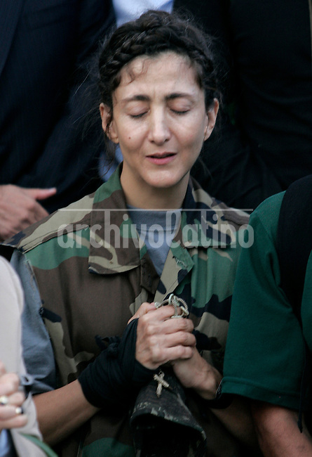 Former hostage Ingrid Betancourt thanks God upon her arrival to Bogota after being rescued from leftist guerrillas FARC that hold her captive during 6 years..