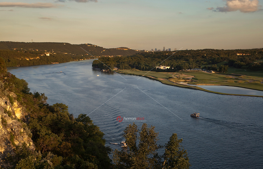 West view of Lake Austin and golf course overlooking the Austin skyline