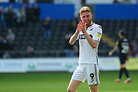 Oli McBurnie of Swansea City applauds the fans at the final whistle during the Sky Bet Championship match between Swansea City and Rotherham United at the Liberty Stadium in Swansea, Wales, UK.  Friday 19 April 2019