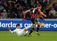 Dan Gosling of Bournemouth  (R) is tackled by Ki Sung Yueng of Swansea during the Barclays Premier League match between Swansea City and Bournemouth at the Liberty Stadium, Swansea on November 21 2015