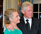 Former United States President Bill Clinton and U.S. Secretary of State Hillary Rodham Clinton look on as the seven recipients of the 2012 Kennedy Center Honors pose for a photo following a dinner hosted by Secretary Clinton at the U.S. Department of State in Washington, D.C. on Saturday, December 1, 2012.  The 2012 honorees are Buddy Guy, actor Dustin Hoffman, late-night host David Letterman, dancer Natalia Makarova, and the British rock band Led Zeppelin (Robert Plant, Jimmy Page, and John Paul Jones)..Credit: Ron Sachs / CNP
