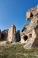 Phrygian and later rock tombs cut into the rocks faces protecting the citadel of Midas . From the 8th century BC . Midas City, Yazilikaya, Eskisehir, Turkey.<br /> <br /> The earliest Phrygian settlement here began in the last quarter of the 8th century BC. Even after the Phrygian kingdom collapsed politically, the city was not abandoned and the Phrygian rock structures and tombs were conserved, with some additions and changes made.in the Persian, Hellenistic, Roman and Byzantine periods.