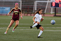Penn's Maya Lacognato (12) plays the ball in front of Brebeuf Jesuit's Caroline Bice (24) during the IHSAA Class 2A Girls Soccer State Championship Game on Saturday, Oct. 29, 2016, at Carroll Stadium in Indianapolis. Special to the Tribune/JAMES BROSHER