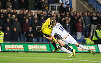 Mark Beevers of Millwall pulls down Danny Hylton of Oxford United outside the area and is shown a red card for the challenge during the Johnstone's Paint Trophy Southern Final 2nd Leg match between Oxford United and Millwall at the Kassam Stadium, Oxford, England on 2 February 2016. Photo by Andy Rowland / PRiME Media Images.