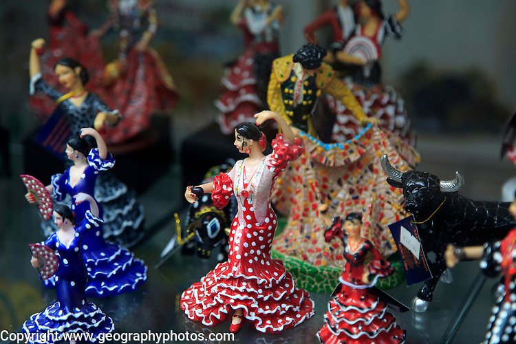 Souvenir gift model figures in shop window display, Benidorm, Spain flamenco dancers bull fighting, matador
