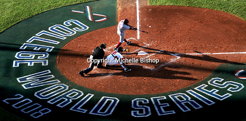 Stanford's Jake Schlander connects with a pitch to drive in a run, giving the Cardinal a 1-0 lead in the third inning. Georgia came from behind to beat Stanford 4-3 in game six of the 2008 College World Series held at Rosenblatt Stadium in Omaha. (Photo by Michelle Bishop).