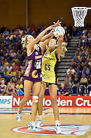 Irene van Dyk ( Pulse ) and Laura Geitz ( Firebirds ) in action during the ANZ Championship - Mojo Pulse v Queensland Firebirds at Te Rauparaha Arena, Porirua, New Zealand on Sunday 8 March 2015. <br />