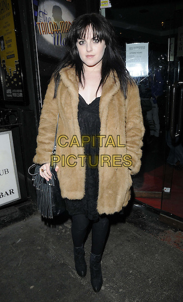 "Niamh Perry.attended the press night performance of ""The Tailor-Made Man"", The Arts Theatre, Great Newport St., The Strand, London, England..February 21st, 2013.full length black fur jacket coat brown tights boots .CAP/CAN.©Can Nguyen/Capital Pictures."