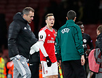 Mesut Ozil of Arsenal with a UEFA official during the UEFA Europa League match at the Emirates Stadium, London. Picture date: 28th November 2019. Picture credit should read: David Klein/Sportimage