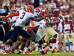 James Wilder Jr breaks through the Syracuse defense for a 32 yard touchdown run as the FSU Seminoles defeat the Syracuse Orange 59-3 at Doak S Campbell Stadium in Tallahassee, Florida November 16, 2013.