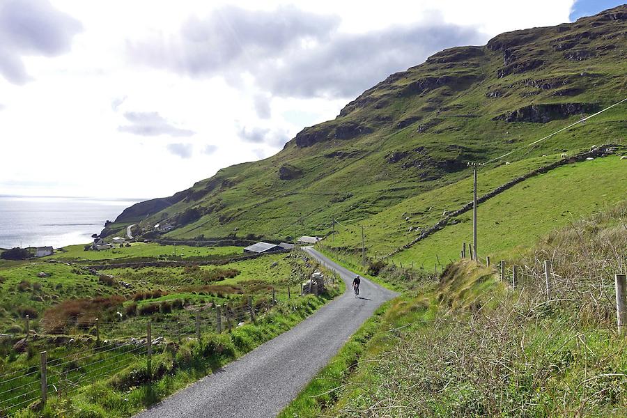 Cycling along County Donegal's Coast Road, Sli an Atlantaigh Fhiáin, Ireland.