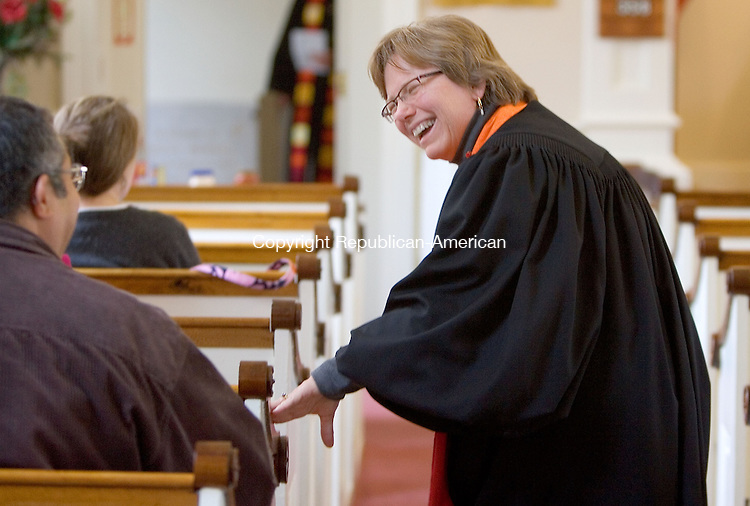 WINSTED, CT. 24 October 2010-102410SV19--Rev. Jacquelyn R. Hall greets guests before she was officially installed as pastor Winchester Center Congregational Church during a ceremony in Winsted Sunday.<br /> Steven Valenti Republican-American