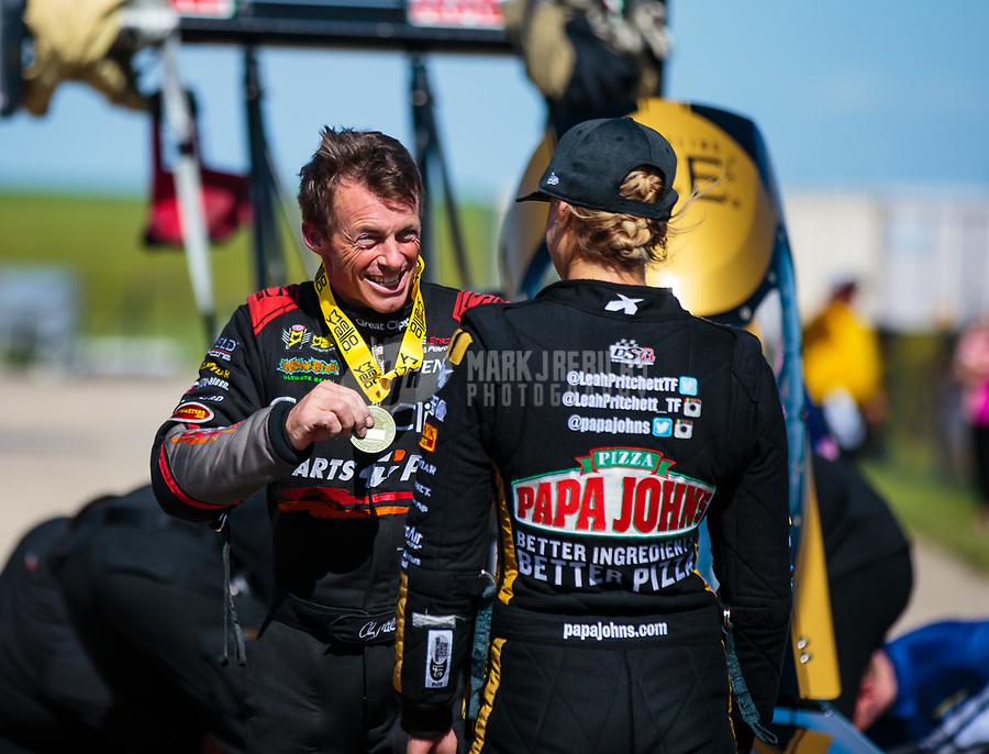 Jun 3, 2018; Joliet, IL, USA; NHRA top fuel driver Clay Millican (left) talks with Leah Pritchett after defeating her in the final round of the Route 66 Nationals at Route 66 Raceway. Mandatory Credit: Mark J. Rebilas-USA TODAY Sports