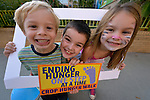 Children pose for a photo after finishing the CROP Hunger Walk, held October 27, 2013, in Raleigh, North Carolina.