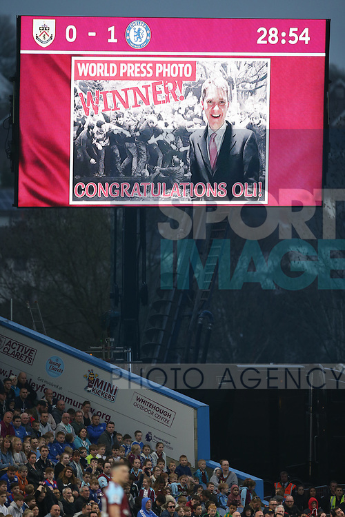 World Press Winner Oli Scarf is advertised on the electronic score board during the premier league match at the Turf Moor Stadium, Burnley. Picture date 19th April 2018. Picture credit should read: Simon Bellis/Sportimage