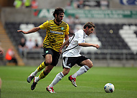 ATTENTION SPORTS PICTURE DESK<br /> Pictured: Angle Rangel of Swansea (R) avoiding Georgios Samaras of Celtic (L)<br /> Re: Premiership pre-season friendly Swansea City FC v Celtic at the Liberty Stadium, south Wales. Wednesday 03 August 2011