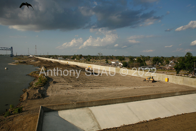 New Orleans, Louisiana.May 25, 2006..Final work on the lower 9th ward levees. The walls are now ready but land is being moved around and two weeks of work remain as hurricane season begins.