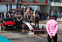 Oct 7, 2018; Ennis, TX, USA; Crew members for NHRA top fuel driver Billy Torrence during the national anthem prior to the Fall Nationals at the Texas Motorplex. Mandatory Credit: Mark J. Rebilas-USA TODAY Sports