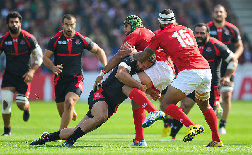 Tonga's Sione Kalamafoni is tackled by Georgia's Giorgi Tkhilaishvili<br /> <br /> Photographer Craig Thomas/CameraSport<br /> <br /> Rugby Union - 2015 Rugby World Cup - 12;00  Georgia v Tonga - Saturday 19th September 2015 - Kingsholm - Gloucester <br /> <br /> &copy; CameraSport - 43 Linden Ave. Countesthorpe. Leicester. England. LE8 5PG - Tel: +44 (0) 116 277 4147 - admin@camerasport.com - www.camerasport.com
