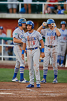 Team mates Ramon Rodriguez (6), Kevin Lachance (5), and Donovan Casey (43) of the Ogden Raptors wait for team mate Romer Cuadrado (17) to round the bases after hitting a grand slam against the Orem Owlz at Home of the Owlz on September 11, 2017 in Orem, Utah. Ogden defeated Orem 7-3 to win the South Division Championship. (Stephen Smith/Four Seam Images)