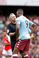 Referee, Jonathan Moss talks with Wesley of Aston Villa during the Premier League match between Arsenal and Aston Villa at the Emirates Stadium, London, England on 22 September 2019. Photo by Carlton Myrie / PRiME Media Images.