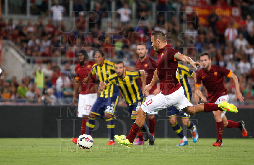 Calcio, amichevole Roma vs Fenerbahce. Roma, stadio Olimpico, 19 agosto 2014.<br /> Roma forward Francesco Totti scores on a penalty kick during the friendly match between AS Roma and Fenerbahce at Rome's Olympic stadium, 19 August 2014.<br /> UPDATE IMAGES PRESS/Isabella Bonotto