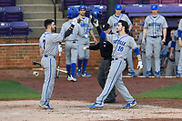 Third baseman Brandon Lankford (10) of the UNC Asheville Bulldogs is congratulated after hitting a home run in a game against the Furman Paladins on Wednesday, February 27, 2019, at Latham Baseball Stadium on the Furman University campus in Greenville, South Carolina. UNC Asheville won, 4-3. (Tom Priddy/Four Seam Images)