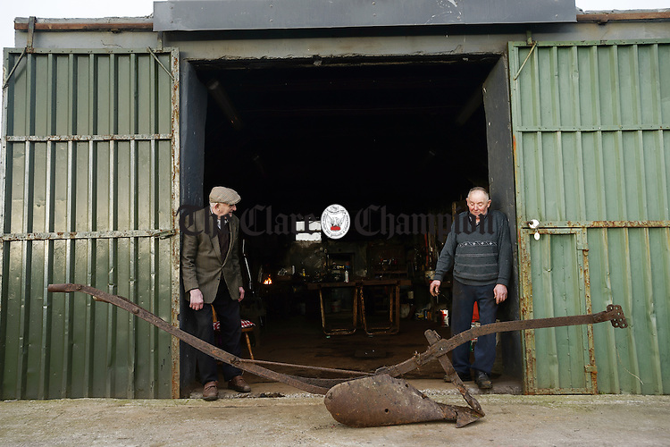 Eighty-two year old blacksmith Thomas Haugh, right, who has retired after a lifetime working in the family forge at Kilclogher, Cross. With him is his eighty-nine year old brother Marty. Photograph by John Kelly.