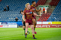 Picture by Allan McKenzie/SWpix.com - 11/05/2018 - Rugby League - Ladbrokes Challenge Cup - Huddersfield Giants v Wakefield Trinity - John Smith's Stadium, Huddersfield, England - Huddersfield's Matty English celebrates his try against Wakefield with Kruise Leeming.