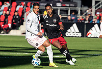 WASHINGTON, DC - MARCH 07: Ola Kamara #9 of DC United goes for the ball with Nicolás Figal #5 of Inter Miami during a game between Inter Miami CF and D.C. United at Audi Field on March 07, 2020 in Washington, DC.